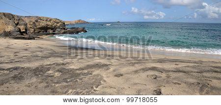 Calm Waves On A Beach
