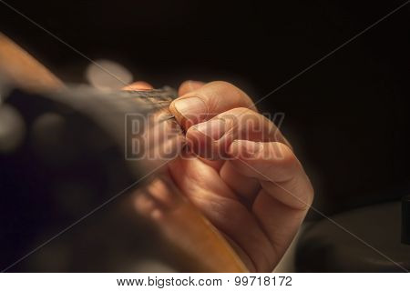 Man's Hand On A Violin Fingerboard