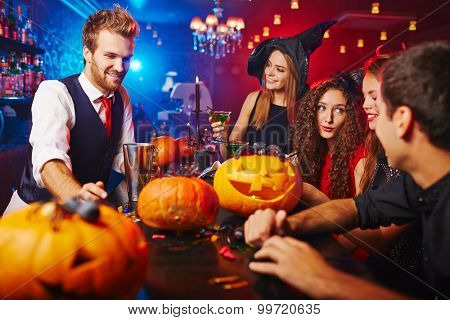 Friends having Halloween program at nightclub