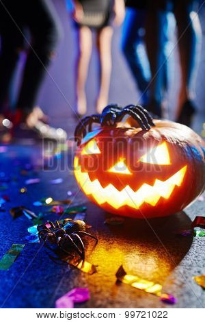 Jack-o-lantern and spider at nightclub
