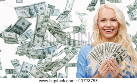 business, money, finance, people and banking concept - smiling businesswoman with dollar cash money