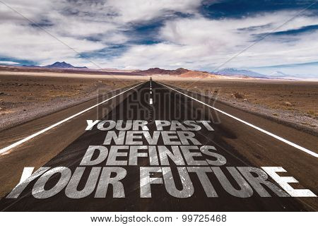 Your Past Never Defines Your Future written on desert road
