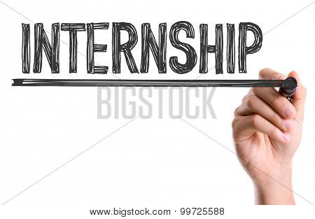 Hand with marker writing the word Internship