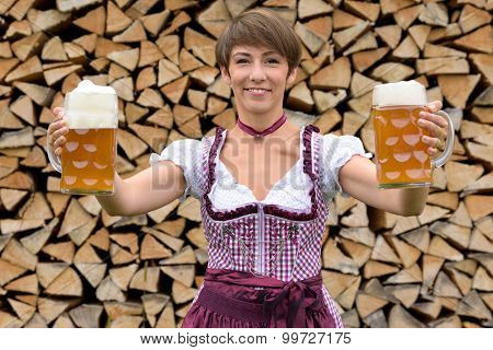 Happy Bavarian Woman Holding Two Tankards Of Beer