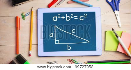 Trigonometry against students table with school supplies