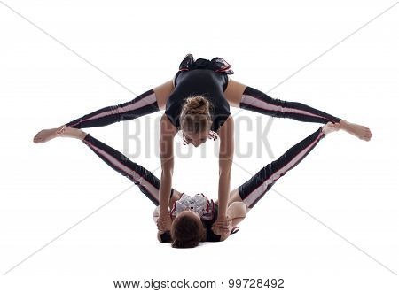 Acrobatics. Girls in difficult stretching pose
