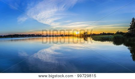 Sunset In Zinnowitz With Reflection Of The Backwater