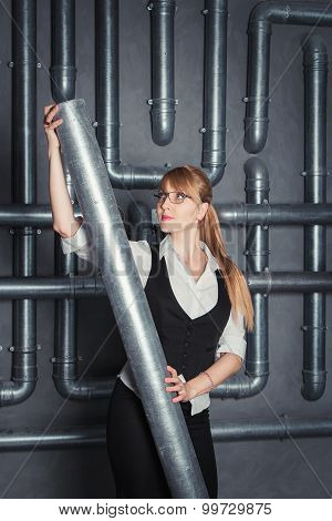 Businesswoman holding PVC pipe