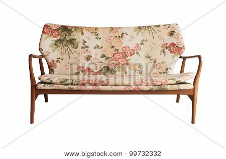Wooden sofa upholstered in floral fabric printed, vintage style