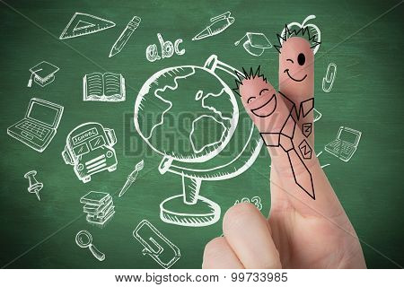 Fingers posed as students against green chalkboard