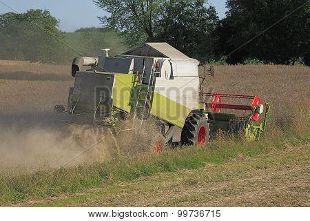 Combine Harvester At Rape Threshing