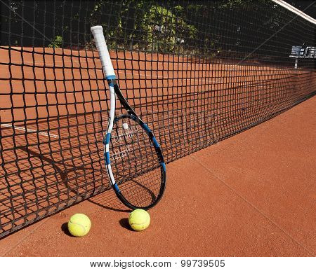 Tennis Balls And  Racket  At The Net