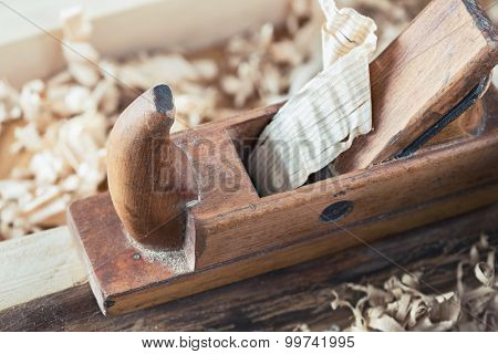 Old wooden hand plane for woodworking and carpentry.