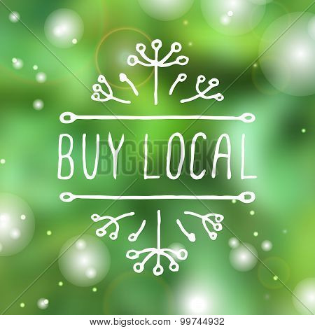 Buy local - product label on blurred background.