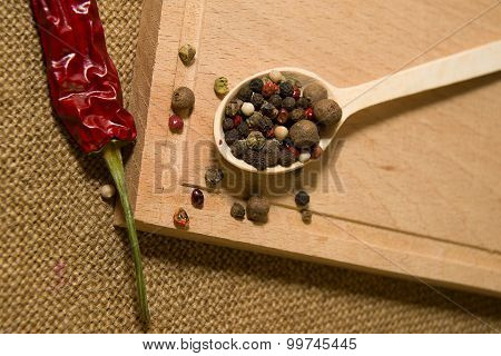 Spoon Filled With Grains Of Pepper And Chilli