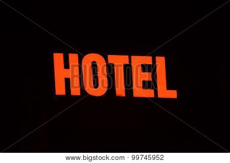 Neon Sign Of A Small Hotel. Picture Made In The Night.