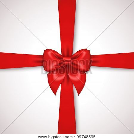 Red Ribbon with Satin Bow Tied Around Gift Box.