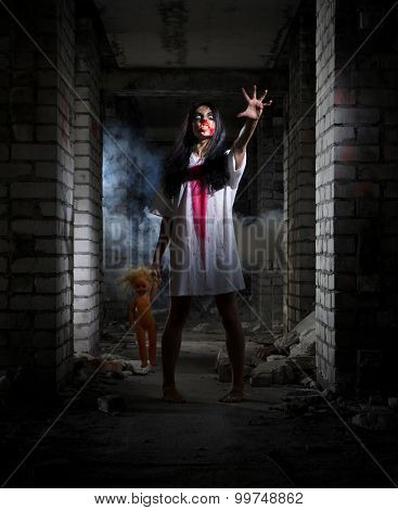 Scary zombie girl in old house