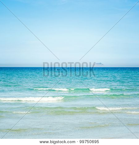 Tropical sandy beach at summer sunny day