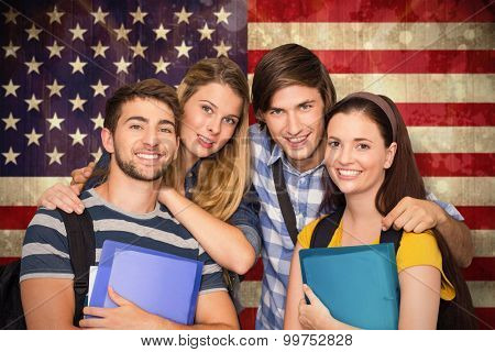 Students holding folders at college corridor against usa flag in grunge effect