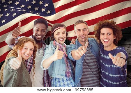 Fashion students smiling at camera together against composite image of digitally generated united states national flag