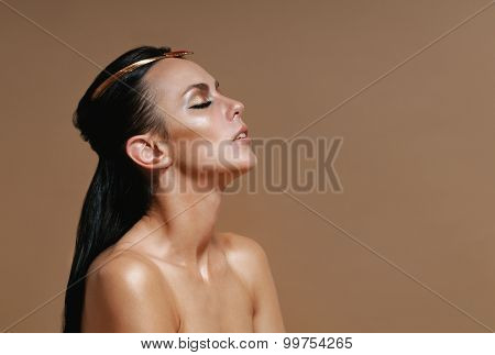 Fashion Portrait Of Sensual Glamourous Woman On Mocha Brown Background