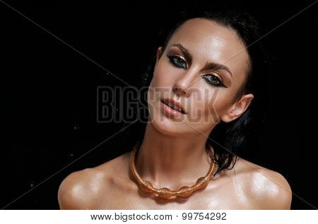 Fashion Portrait Of Shining Glamourous Woman On Black Background