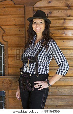Woman In Lederhosen And Bavarian Hat