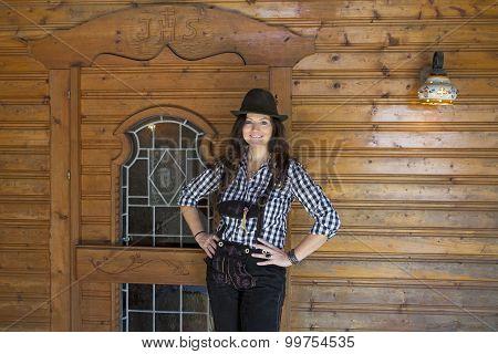 Woman In Lederhosen And Hat