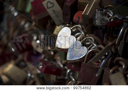 Silver Love Locks In Heart Shape On A Bridge Railing
