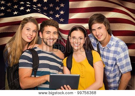 Students using digital tablet at college corridor against composite image of digitally generated united states national flag