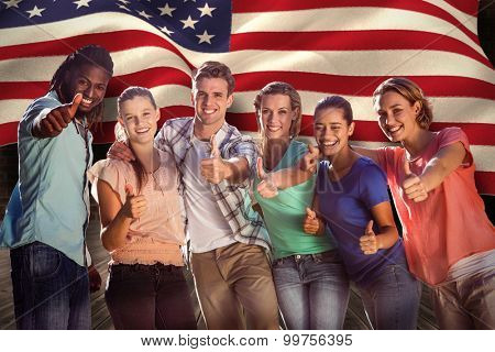 Happy friends in the park against composite image of digitally generated united states national flag