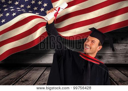 Happy attractive boy celebrating his graduation against composite image of digitally generated united states national flag
