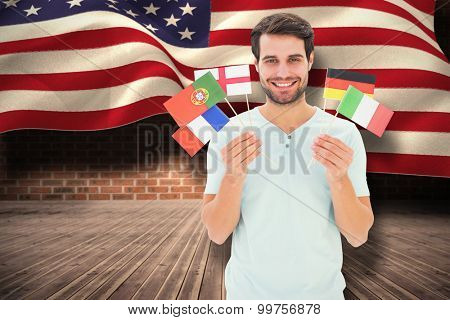 International student against composite image of digitally generated united states national flag