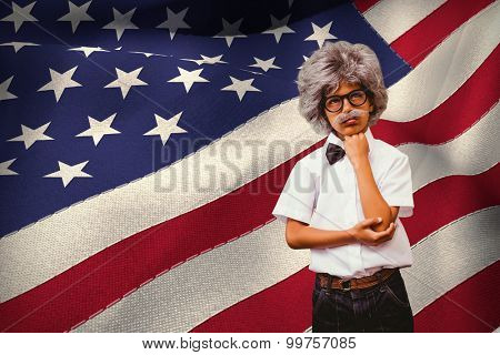 Pupil dressed up in wig against digitally generated american national flag