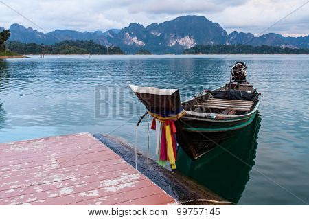 Longtail Boat In Lake . Ratchaprapha Dam At Khao Sok National Park