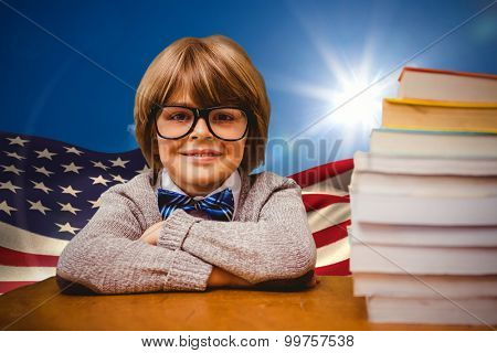 Pupil with many books against digitally generated american flag rippling