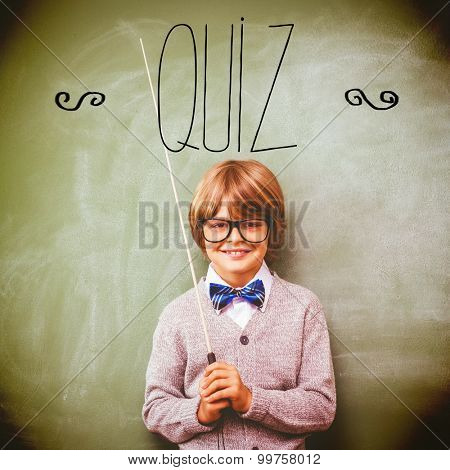 The word quiz against portrait of cute little boy holding stick