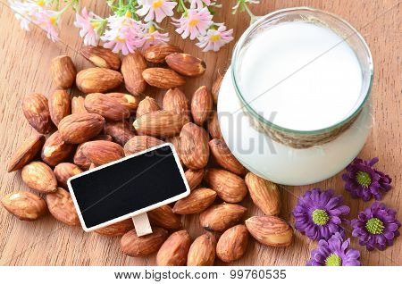 Almond And Almond Milk With Blank Black Wooden Tag For Your Text