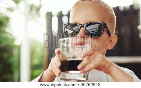 Cute Hipster Little Boy In Over Sized Sunglasses
