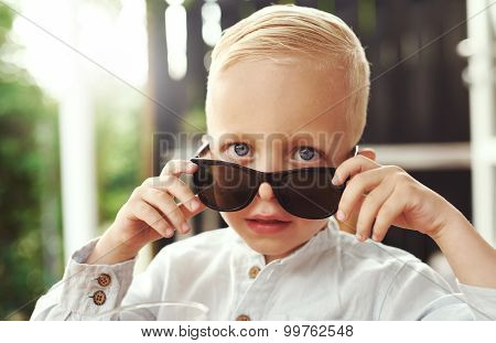 Handsome Little Boy In Trendy Sunglasses