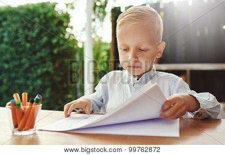 Neat Methodical Little Boy Doing Art