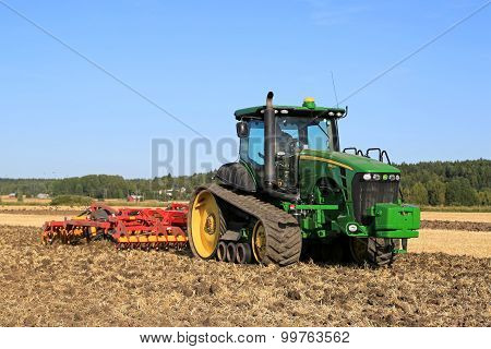 John Deere 8345Rt Tracked Tractor And Vaderstad Cultivator On Field