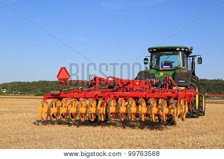 Vaderstad Opus 400 Cultivator And John Deere Tractor On Field