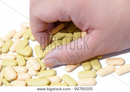 Male's Hand Grab Vitamin Pills