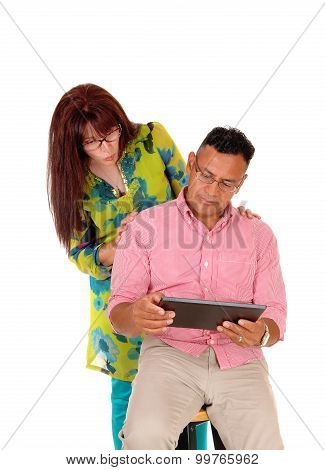 Couple Playing With Tablet Computer.