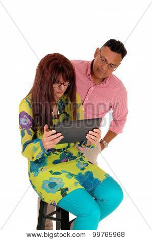 Husband And Wife Looking At There Tablet.