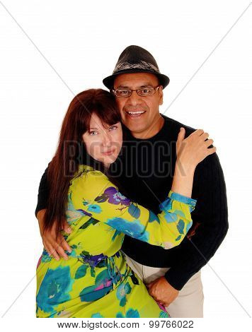 Woman Hugging Her Hispanic Man.