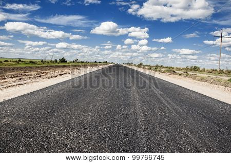 Perspective of asphalt road with blue sky.