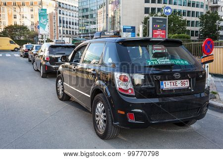 Green Electric Taxi In Brussels, Belgium